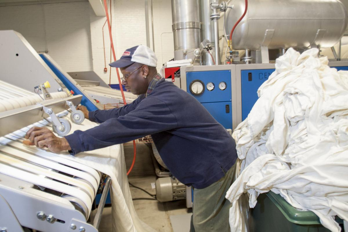 A worker at Evergreen Laundry Cooperative in Cleveland, Ohio.
